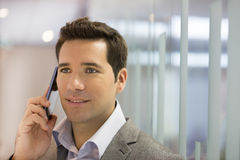 Successful businessman talking on cell phone Stock Images