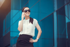 Successful businessman talking on cellphone. Stock Images