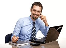 Successful businessman talking by cellphone while working with laptop isolated on white Stock Image