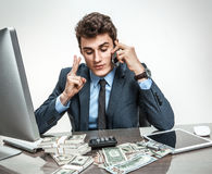 Successful businessman talking by cellphone Stock Photos