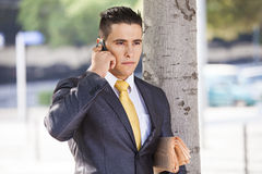 Successful  businessman talking at his cellphone Stock Photos