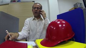 Successful Businessman Talking on Mobile Phone in the Office stock footage
