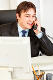 Successful businessman talking on phone Stock Photos