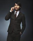 Successful businessman talking on phone Stock Image
