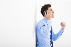 Successful businessman talking on the phone in office Stock Images