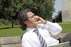 Successful businessman talking on the phone outdoo Royalty Free Stock Photography