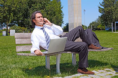 Successful businessman talking on the phone outdoo Stock Image