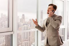 Successful businessman talking on smartphone Stock Photos