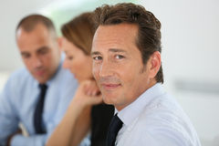 Successful businessman with team Royalty Free Stock Photo