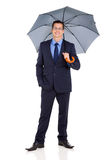 Successful businessman umbrella Stock Photography