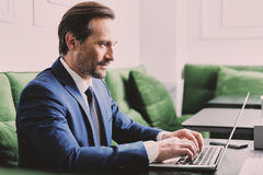 Successful businessman using notebook for work Stock Photography