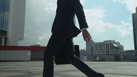 Successful businessman walking in big city, confident and ambitious young man. Stock footage stock video footage
