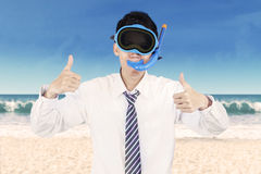 Successful businessman wearing snorkeling tools Stock Image