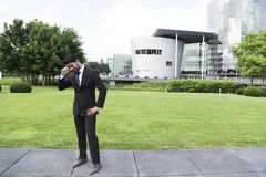 Successful businessman or worker standing in suit near office building Royalty Free Stock Photos