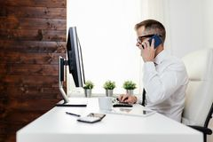 Successful businessman working in his office royalty free stock images