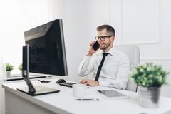 Successful businessman working in his office royalty free stock photo