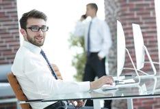 Portrait of successful businessman on workplace. Successful businessman on workplace in modern office Stock Photos