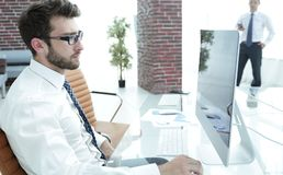 Portrait of successful businessman on workplace. Successful businessman on workplace in modern office Stock Images