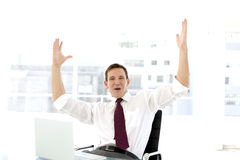 Successful businessman at workplace Stock Photos