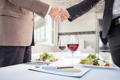 Successful businessmen are signing a contract in Stock Photography