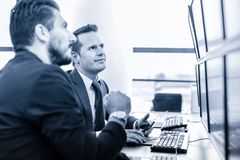 Successful businessmen in trading office. Business success. Stock Image