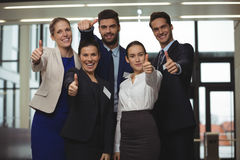 Successful businesspeople showing thumb up sign Royalty Free Stock Image