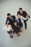 Successful businesspeople showing victory sign Royalty Free Stock Photo
