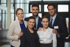 Successful businesspeople standing together in office Stock Photo