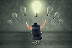 Successful businessperson under bright lightbulb Royalty Free Stock Images