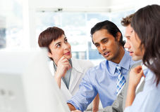 Successful businessteam working at a computer Stock Images