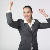 Successful businesswoman. A beautiful young businesswoman showing her fists up  like she have success Stock Photography