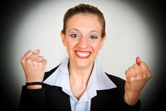 Successful businesswoman with arms up Stock Images