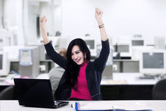 Successful businesswoman with arms up Royalty Free Stock Photos