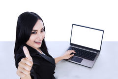Successful businesswoman and blank laptop - isolated Royalty Free Stock Photos