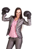 Successful businesswoman in  boxing gloves Stock Photos