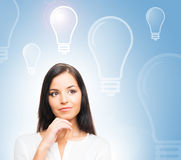 A successful businesswoman with bulbs Stock Photo