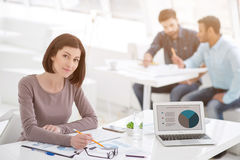 Successful businesswoman and business team at office meeting Royalty Free Stock Photography