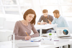 Successful businesswoman and business team at office meeting Royalty Free Stock Image