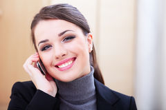Successful businesswoman with cell phone. Happy successful businesswoman with cell phone Stock Image