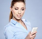 Successful businesswoman with cell phone. Happy smiling successful businesswoman with cell phone Royalty Free Stock Images