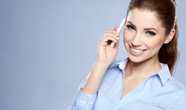 Successful businesswoman with cell phone. Happy smiling successful businesswoman with cell phone Stock Photography