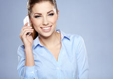 Successful businesswoman with cell phone. Happy smiling successful businesswoman with cell phone Stock Image