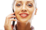 Successful businesswoman with cell phone. Happy smiling successful businesswoman with cell phone, isolated on white background Royalty Free Stock Photo