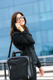 Successful businesswoman on cellphone in street Royalty Free Stock Photography
