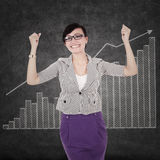 Successful businesswoman with chart Royalty Free Stock Photos