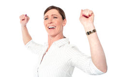Successful businesswoman with clenched fists. Isolated corporate lady celebrating her victory Stock Image