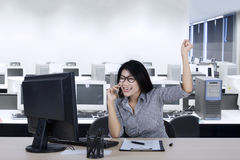 Successful businesswoman with computer and mobile phone Royalty Free Stock Photo