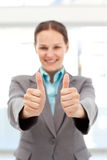 Successful businesswoman doing thumbs up Stock Images