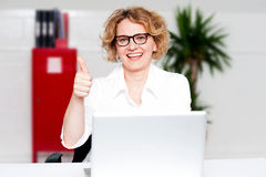 Successful businesswoman gesturing thumbs up Royalty Free Stock Photography
