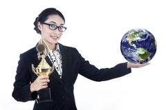 Successful businesswoman hold trophy and globe Royalty Free Stock Images